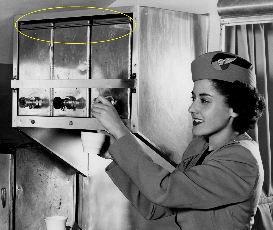 The beverage containers were located in the aircraft galley and contained various beverages for the passengers.