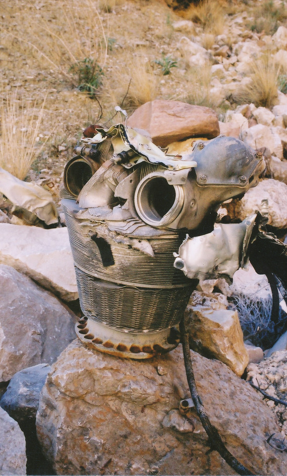 Cylinder and head from one of the DC-7's four R-3350 Turbo-Compound Engines. Located during the 2002 trip on the north talus slope below the point of impact.