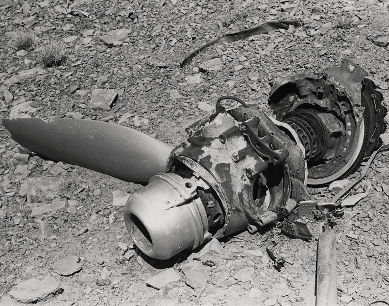 The propeller and hub with parts of the reduction gearbox attached is all that remains of one of the DC-7's four turbo-compound engines on upper ledge of Chuar Butte. (LostFlights Archive Photo)
