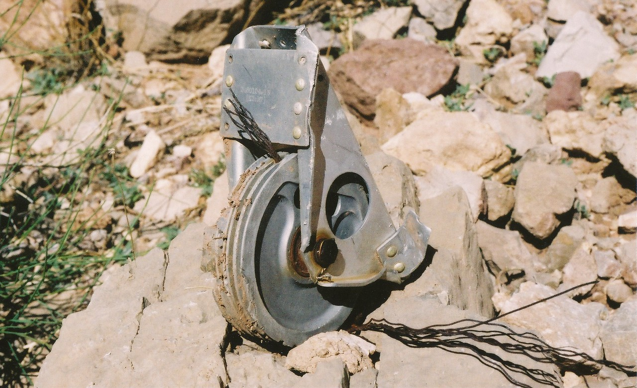 DC-7 flight control pulley assembly with attached cable on the south talus slope of Chuar Butte. (2002 Trip)