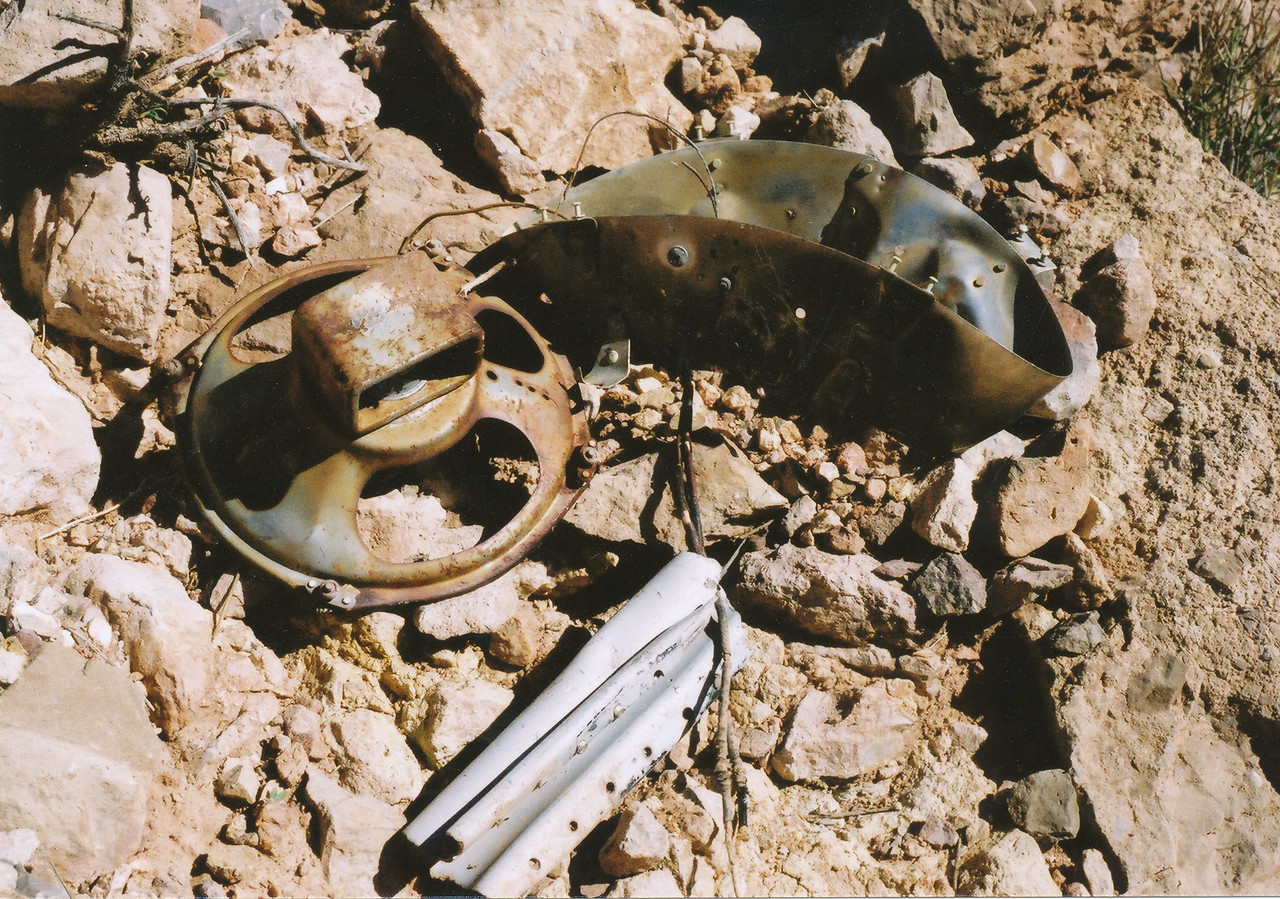Remains of an audio speaker sits amid other wreckage from the UAL DC-7 on Chuar Butte. (2002 Trip)