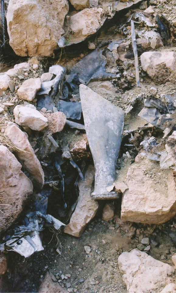A propeller fragment from the TWA plane amid burned and melted debris at bottom of ravine. (2002  LostFlights)