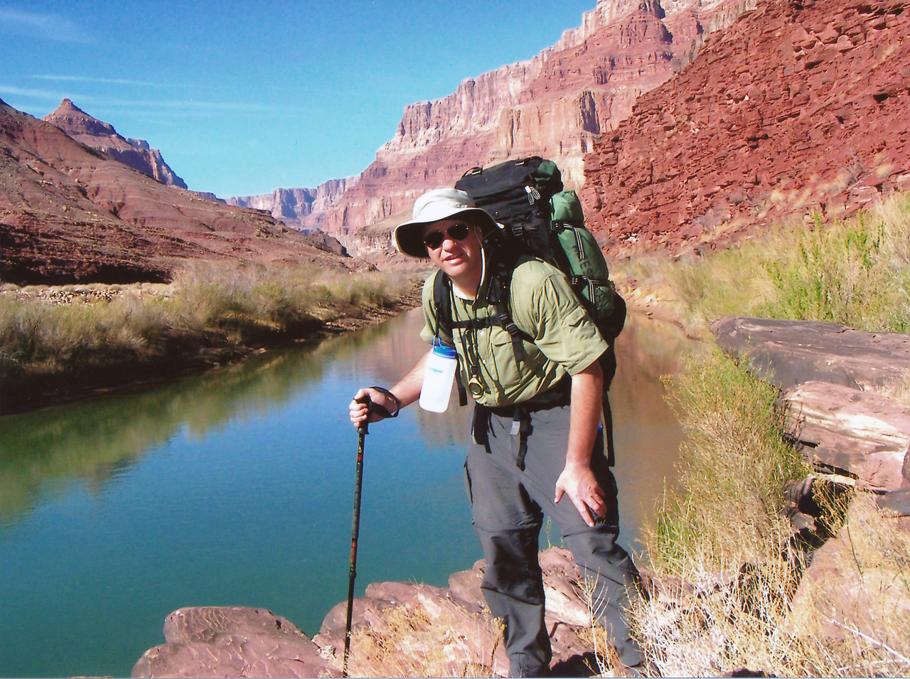 March 2006. Day 2 on the lower Beamer Trail near a small river tributary. From the way im standing you can tell the pack is still heavy at about 80 pounds. <br /> <br /> At this point I have about 6 miles to hike before I reach the confluence of the Colorado and Little Colorado Rivers.