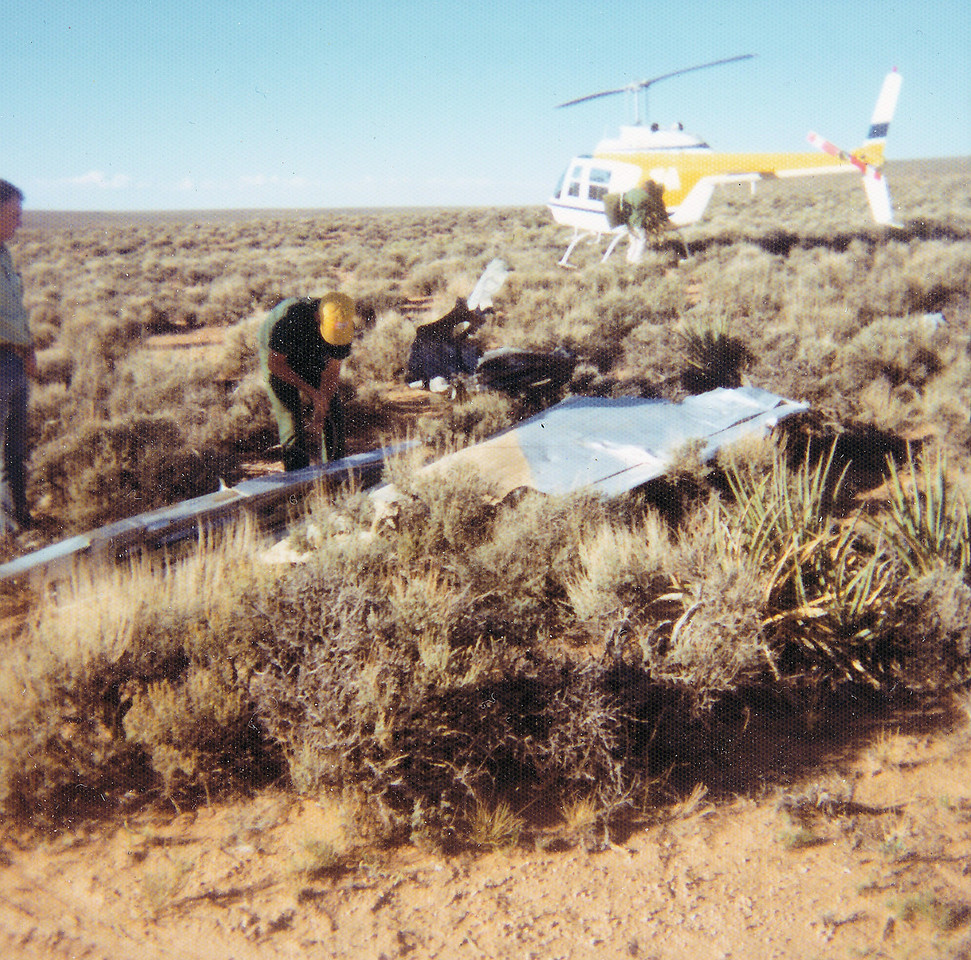WRECKAGE RECOVERY OPERATION - 1976<br /> <br /> Salvage crews dismantling wreckage on the east rim during the October 1976 clean-up operation. (1976 NPS Photo)