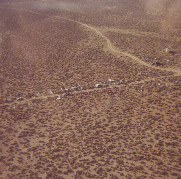 Wreckage lined this remote dirt road on the east rim during the wreckage removal operation of 1976. Gone to the scrap yard was the Lockheed Constellation's triple tail section and most of the wreckage from both main impact sites. (1976 NPS Photo)