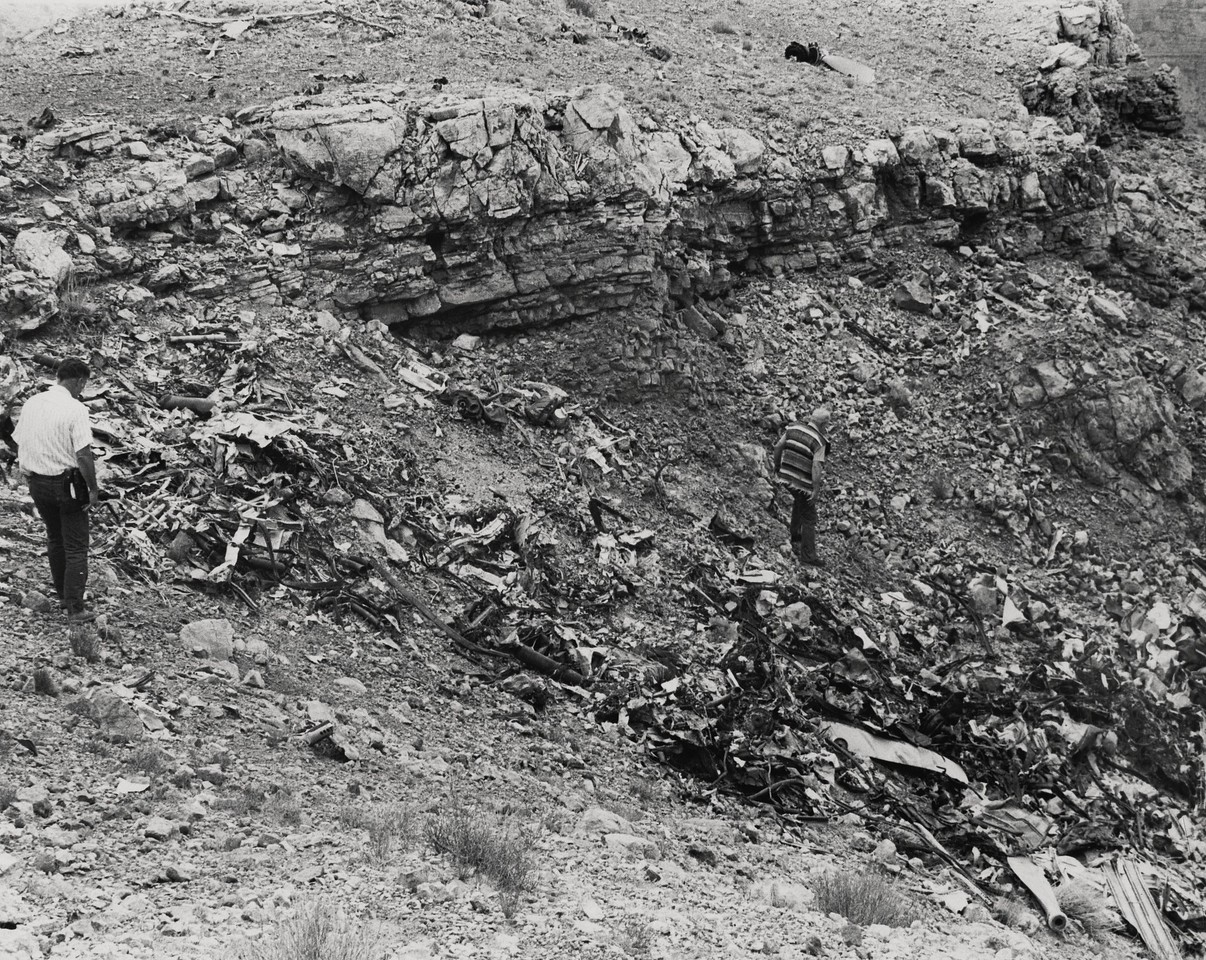 United Air Lines was the last airline to agree on the removal of wreckage. The delay by UAL was primarily due to the dangers involved with reaching the crash site atop the 1,000' ledge on Chuar Butte. <br /> <br /> This photo shows the point of impact made by the DC-7 when it struck the ledge. (LostFlights Archive Photo)
