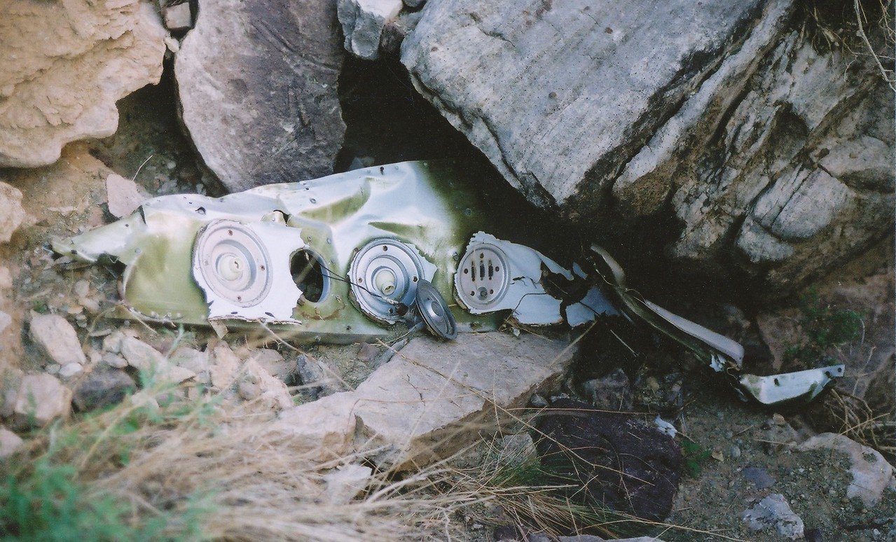 Discovered during the 2002 examination trip, the overhead passenger cabin light/air vent panel from the aft lounge was found several hundred feet from the TWA impact site. <br /> <br /> This fragment was one of many pieces of cabin interior pulled from the aircraft during the tail separation and free-fell to this location.