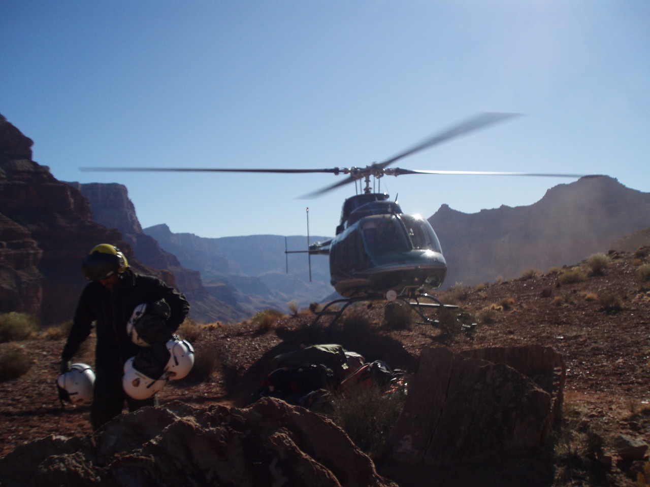 The old under-powered Chinook and Sikorsky Helicopters that were used during the 1956 recovery operations have been replaced by modern helicopters such as the jet-powered Bell 407. This photo taken at the impact site of United Flight 718 on Chuar Butte. (NPS Photo)