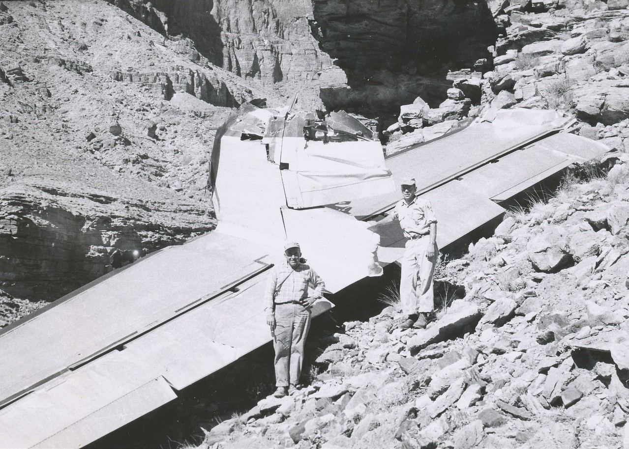 July 1956 photo showing park rangers posing with TWA tail section during the recovery operation. (LostFlights Archive Photo)