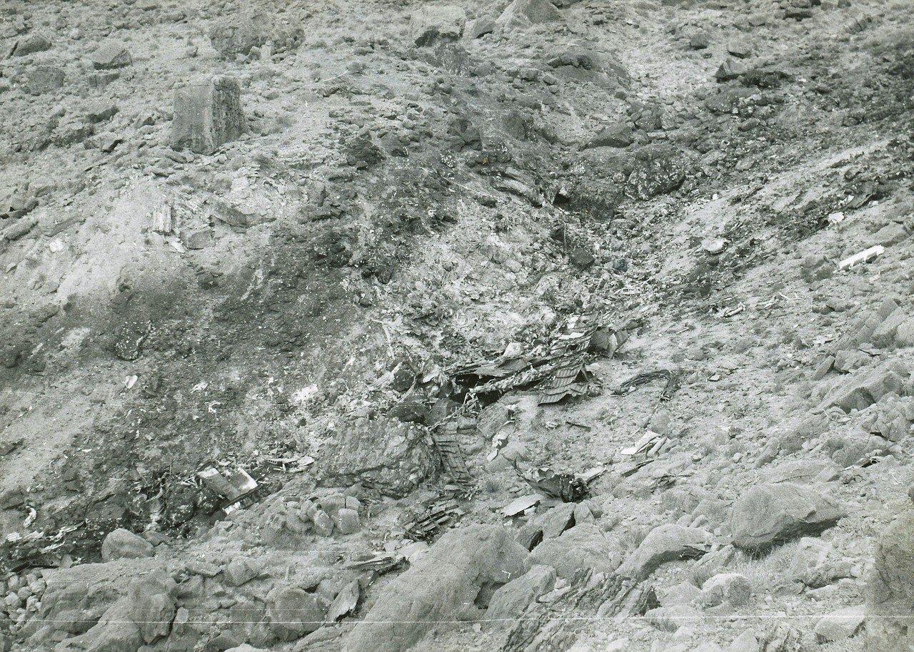 Overview photo of the TWA main impact site taken during July 1956. After the collision and with the separation of the tail section, the Constellation pitched over and decended vertically and inverted until impact.