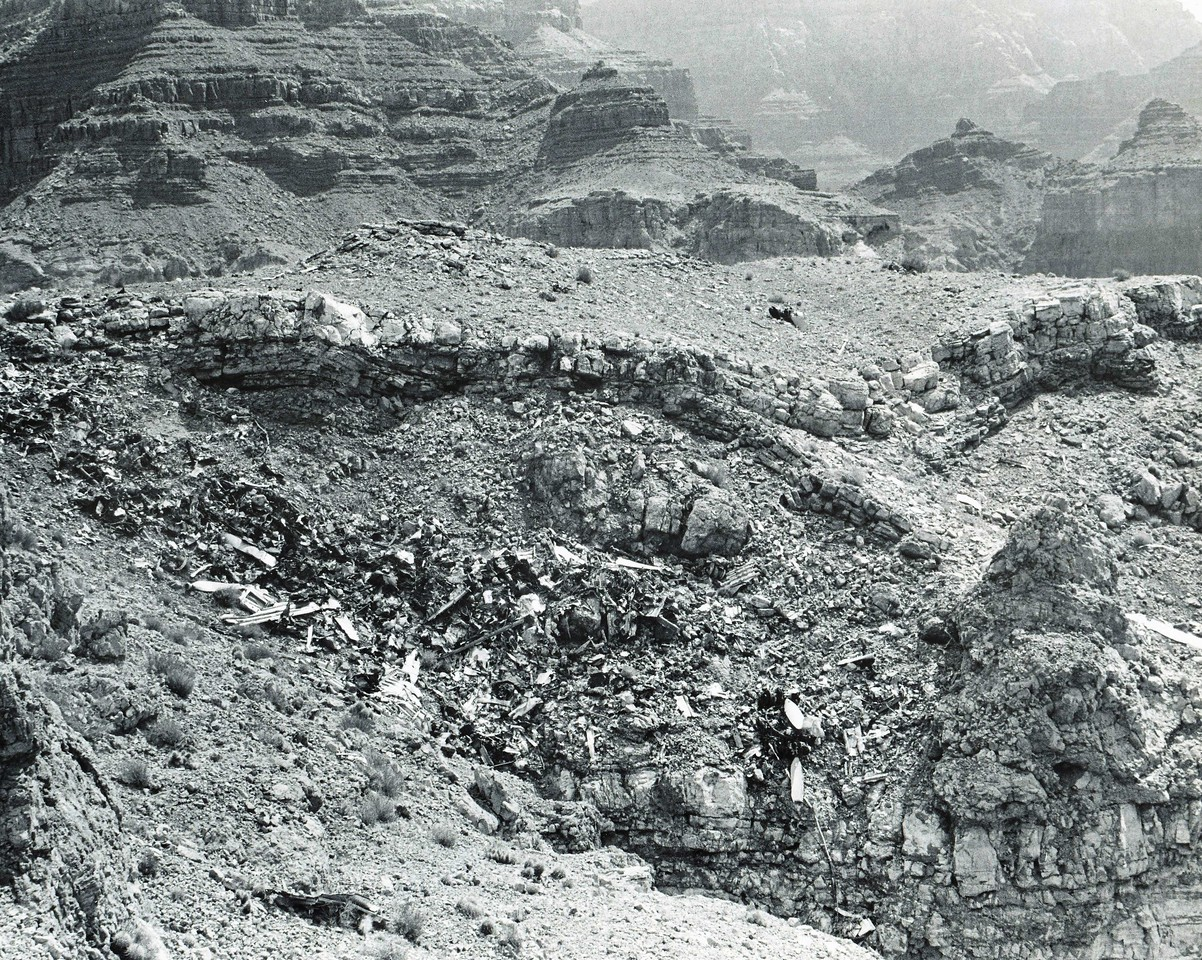 This photo taken in 1975 was used by the park service to show United Air Lines the amount of wreckage remaining at the UAL DC-7 site. Similar photos were sent to TWA showing the remaining wreckage on Temple Butte. <br /> <br /> After months of letters with attorneys from both airlines and the NPS, it was decided that the wreckage from both crash sites would be removed during October 1976. (1975 NPS Photo)