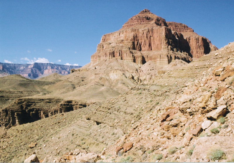 The south spire of Temple Butte as seen from the Upper-Beamer Trail. The trail generally follows the contour of the Tapeats layer at about 400-500 feet above the Colorado River.
