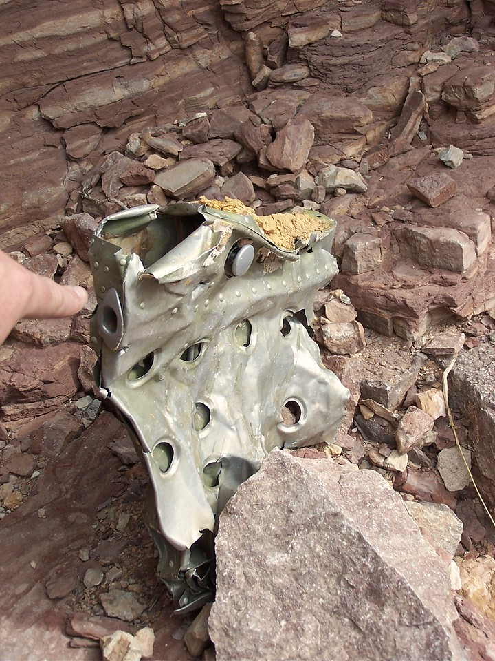 At the base of the cliff on Chuar Butte I found the remains of a passenger seat armrest from the DC-7. (2006 LostFlights)