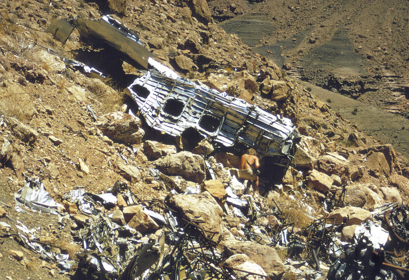 The remains of passenger seats in the form of twisted seat frames piled in the foreground of this photo gives testimony to the human toll of TWA Flight 2. (LostFlights Archive Photo)