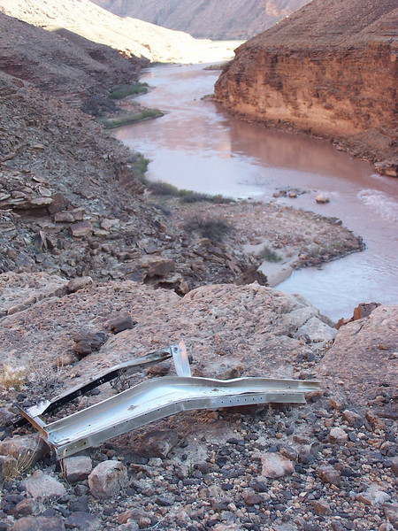 "Remnants of the aft Hostess ""Jump-Seat"" consisted of a piece of seat frame discovered on a ledge high above the Colorado River.<br /> <br /> This seat was originally attached to the aft cabin bulkhead that was discovered in a ravine above the TWA main impact site."