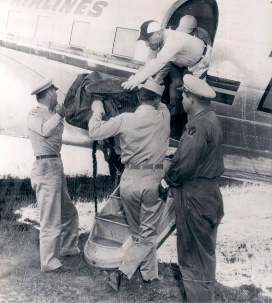 the last of Flight 2's victims are loaded onto a TWA DC-3 for the short flight from Grand Canyon Red Butte Airport to Flagstaff. (LostFlights Archive Photo)