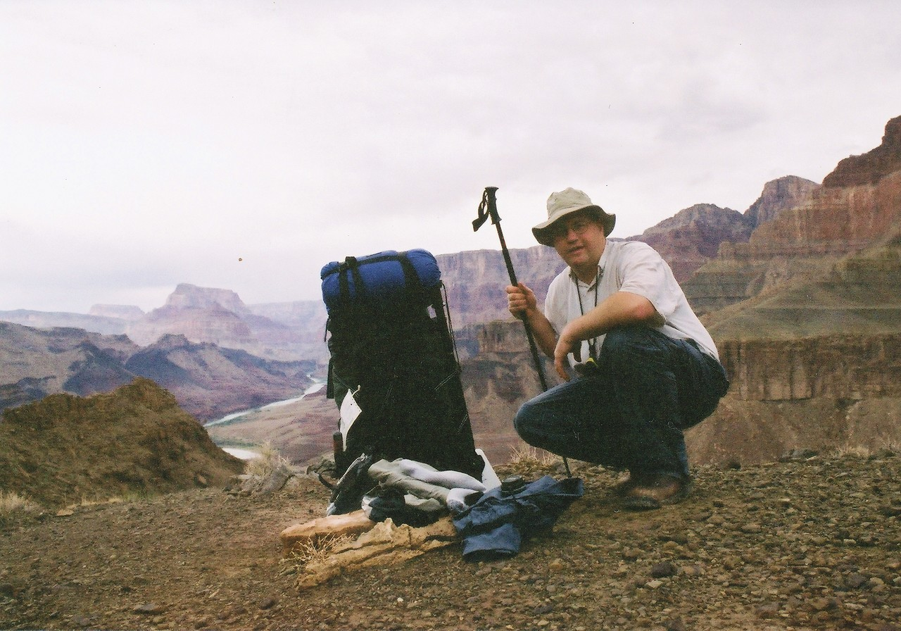 Stopping for a photo on the Tanner Trail below the red wall formation. The pack in the photo weighs about 90 pounds. (2002 Examination Trip)