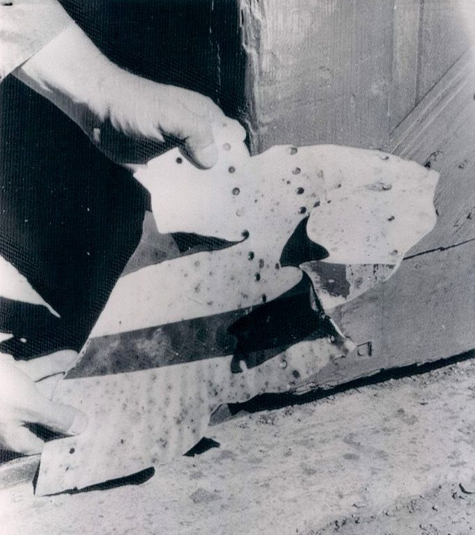 This piece of collision related wreckage from the TWA Constellation bears a painted red stripe. It was recovered by investigators from the UAL DC-7 impact site. (LostFlights Archive Photo)