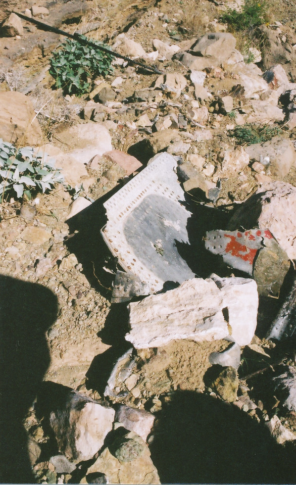 This photo taken during the 2002 examination trip at the TWA impact site, shows a lower wing fragment along with a red painted fragment from either the wing or fuselage. (2002 LostFlights)