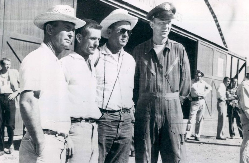 Relatives of Mrs. Leland Evans, a passenger from TWA Flight 2 speaks with U.S. Air Force Captain Byrd Ryland. Capt. Ryland was Commander of the combined search operation for the missing airliners. <br /> <br /> Pictured from left to right are Edwin Evans, Arnold Evans and Roy Elder. Mrs. Evans husband was a test pilot for TWA. She was traveling on a company pass. (LostFlights Archive Photo)