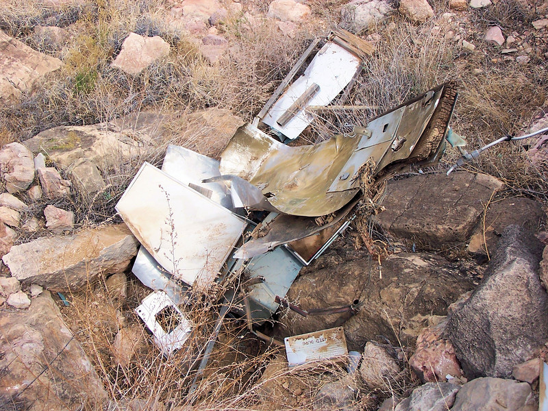 As I hiked up a dry drainage above the TWA impact site, I came across this pile of wreckage from the Lockheed Constellation. <br /> <br /> Further examination revealed an interior cabin bulkhead  amid other interior parts that were pulled from the aircraft during separation of the Connie's tail section. (2006 Trip)