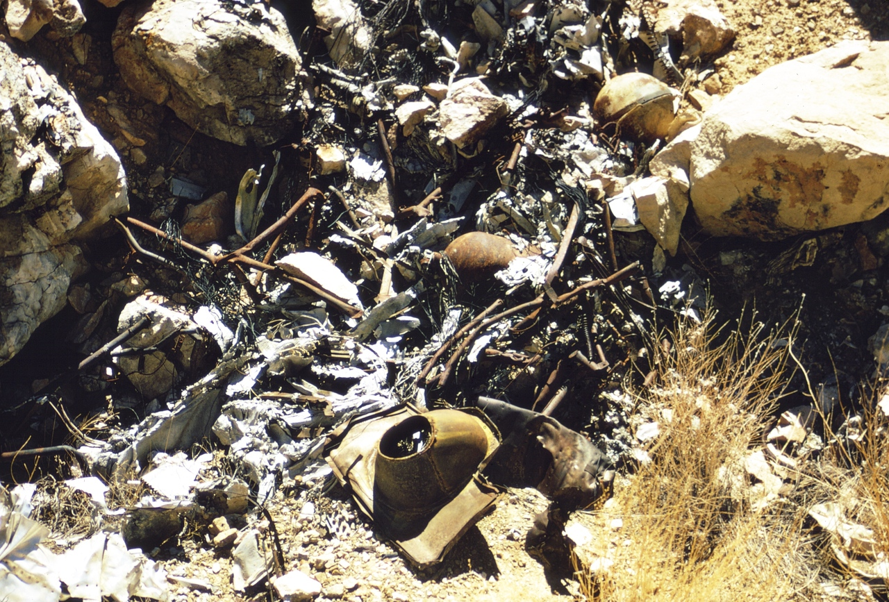This pile of debris in the burn area of the TWA site contains a few identifiable items such as a supplemental oxygen bottle, passenger seat frames, and engine exhaust fittings.<br /> <br /> Based on the types of melted alloys found at the site, it has been estimated that tempertures reached in excess of 1,800 degrees as the wreckage burned. (LostFlights Archive Photo)