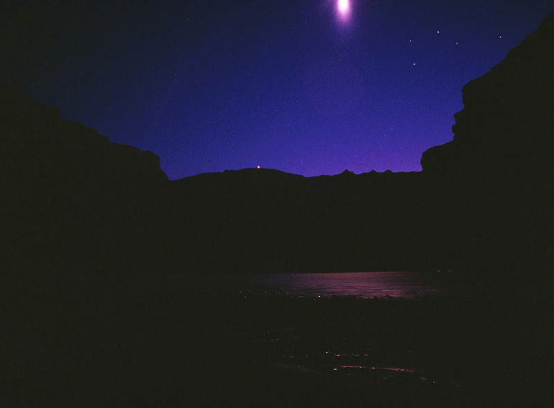Twilight in Grand Canyon. I took this photo in October 1990 on my first night camping in the canyon. The point of light visible on the canyon rim is the Desert View Watchtower. The constellation of stars is Scorpio (1990 Examination Trip)