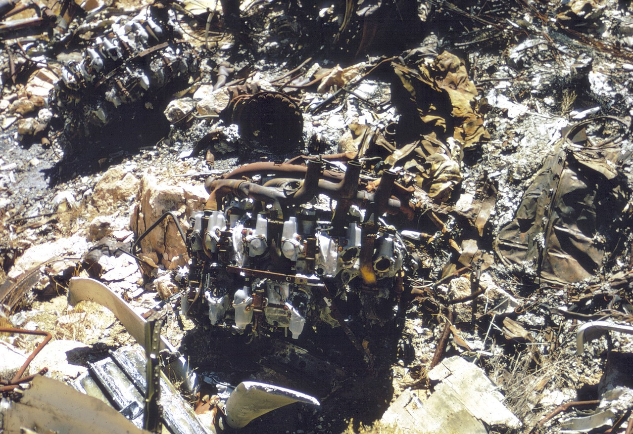 The remains of once was two functional Wright R-3350 engines lay lifeless amid the burned and melted wreckage at the TWA impact site. (LostFlights Archive Photo)