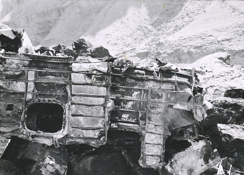 A burned forward fuselage fragment photographed at the TWA impact site, July 1956. (NPS Photo)