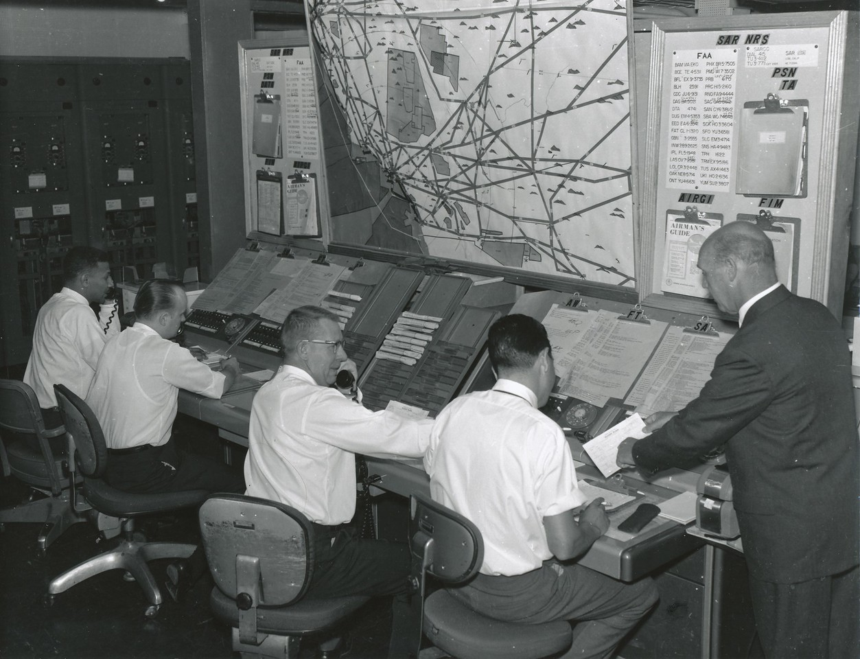 AIR TRAFFIC CONTROL - 1956<br /> <br /> Los Angeles Center handled both flights until they crossed the Colorado River into Arizona. The flights were then monitored by by either Denver or Salt Lake City Air Traffic Control (ATC).<br /> <br /> There was no ATC radar coverage across most of the U.S. in 1956. Commercial airliners would report positions to controllers and estimate their time to the next position. (LostFlights Archive Photo)