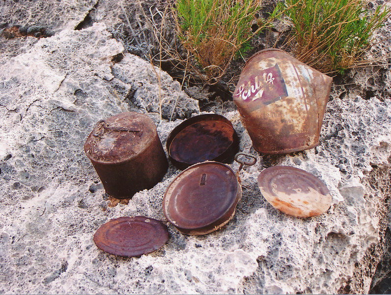 "1956-57 RECOVERY TEAM ARTIFACTS:<br /> <br /> A small collection of empty ration containers left behind by recovery teams during the 1956 efforts on Temple Butte. A beer can?? During July 1956 it was pushing 105-110 degrees in the canyon!<br /> <br /> This material is no longer considered ""trash"" by the National Park Service and is protected by historical preservation laws. (2006 LostFlights)"