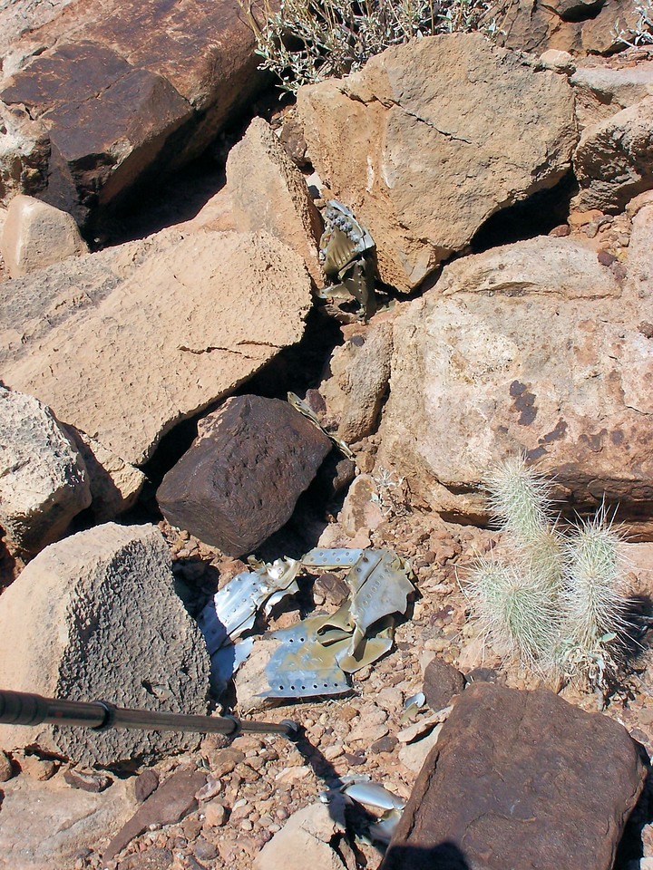 Tail section fragments amid rocks and cactus. (2006 LostFlights)