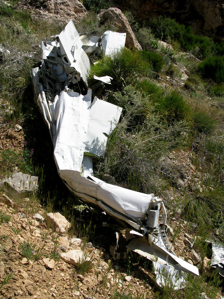 Both left and right wings separated from the fuselage at impact. The left wing was located nearly thirty feet away from the right wing, fuselage, and tail section.