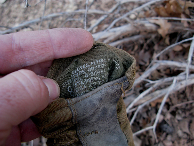 The printed information inside the gloves indicate that the gloves were U.S. Government issued. Captain Gustafson as with most pilots for Las Vegas Airlines was a retired military pilot.