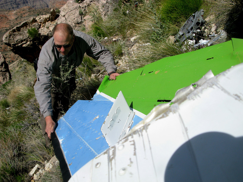 Examining damage to the vertical stabilizer and rudder assembly. <br /> <br /> Although somewhat faded, after nearly three decades the aircraft's overall exterior paint was still in good condition.