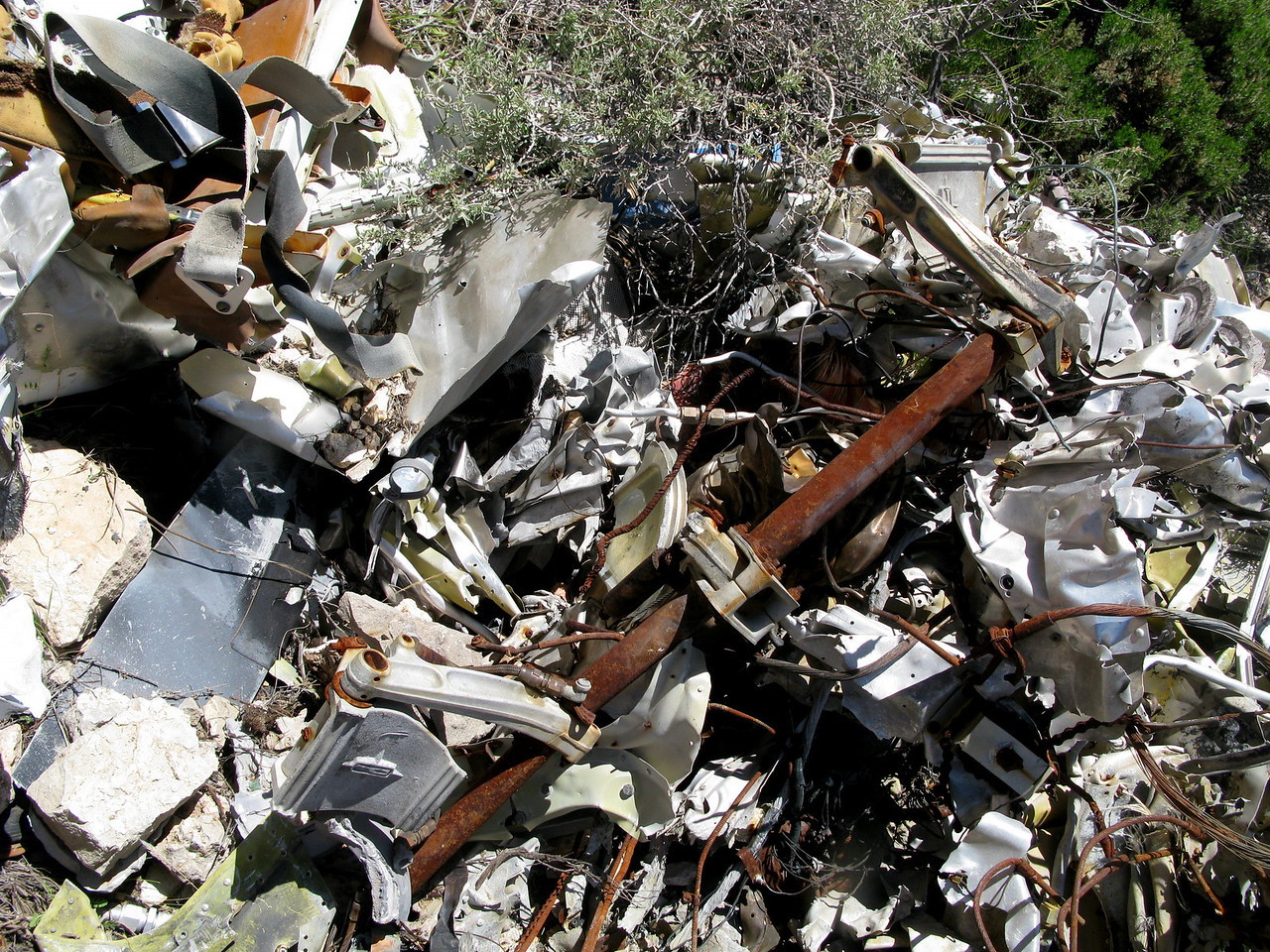 A post crash fire consumed most of the forward fuselage and passenger cabin. The rudder pedals and control armature are visible in this photo.