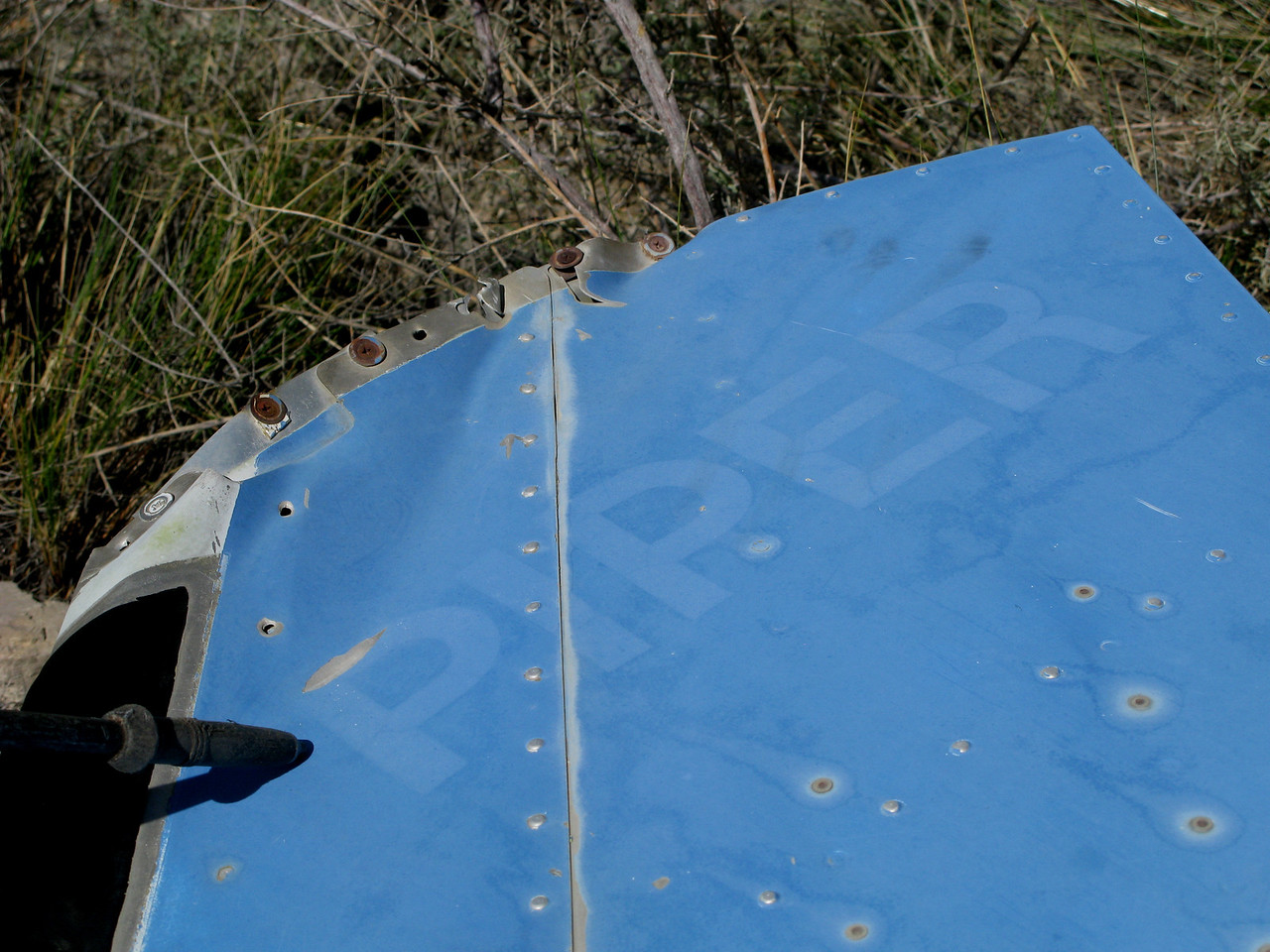 "Faded over time, the ""PIPER"" name on the upper vertical stabilizer was originally painted white."