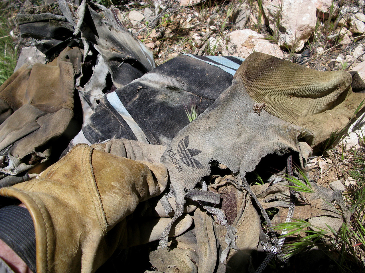 The tattered remnants of a passenger's Adidas jacket. <br /> <br /> Even though August was generally a warm summer month, the cool rainy weather on the day of the accident had passengers bringing along extra warm clothing.