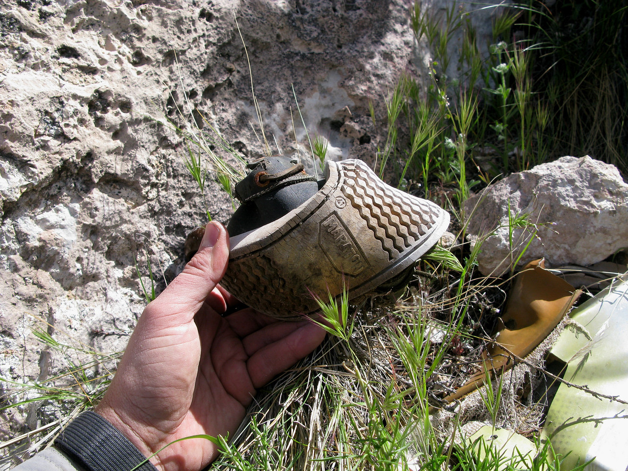 In addition to various articles of clothing scattered at the crash site were the shoes of the accident victims.<br /> <br /> This tennis shoe, manufactured by Maraton shows the European shoe sizing of 47 on the sole.