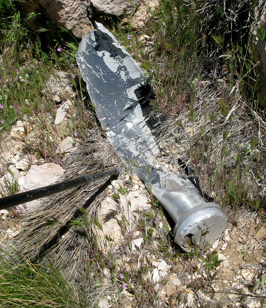 The aircraft's three-bladed Hartzell propellers struck the cliff face with such force that all six blades separated from their hubs and were thrown in every direction. <br /> <br /> The blades and blade fragments I found at the crash site all exhibited rotational scratch marks, deep cuts, and gouging on the leading edges.