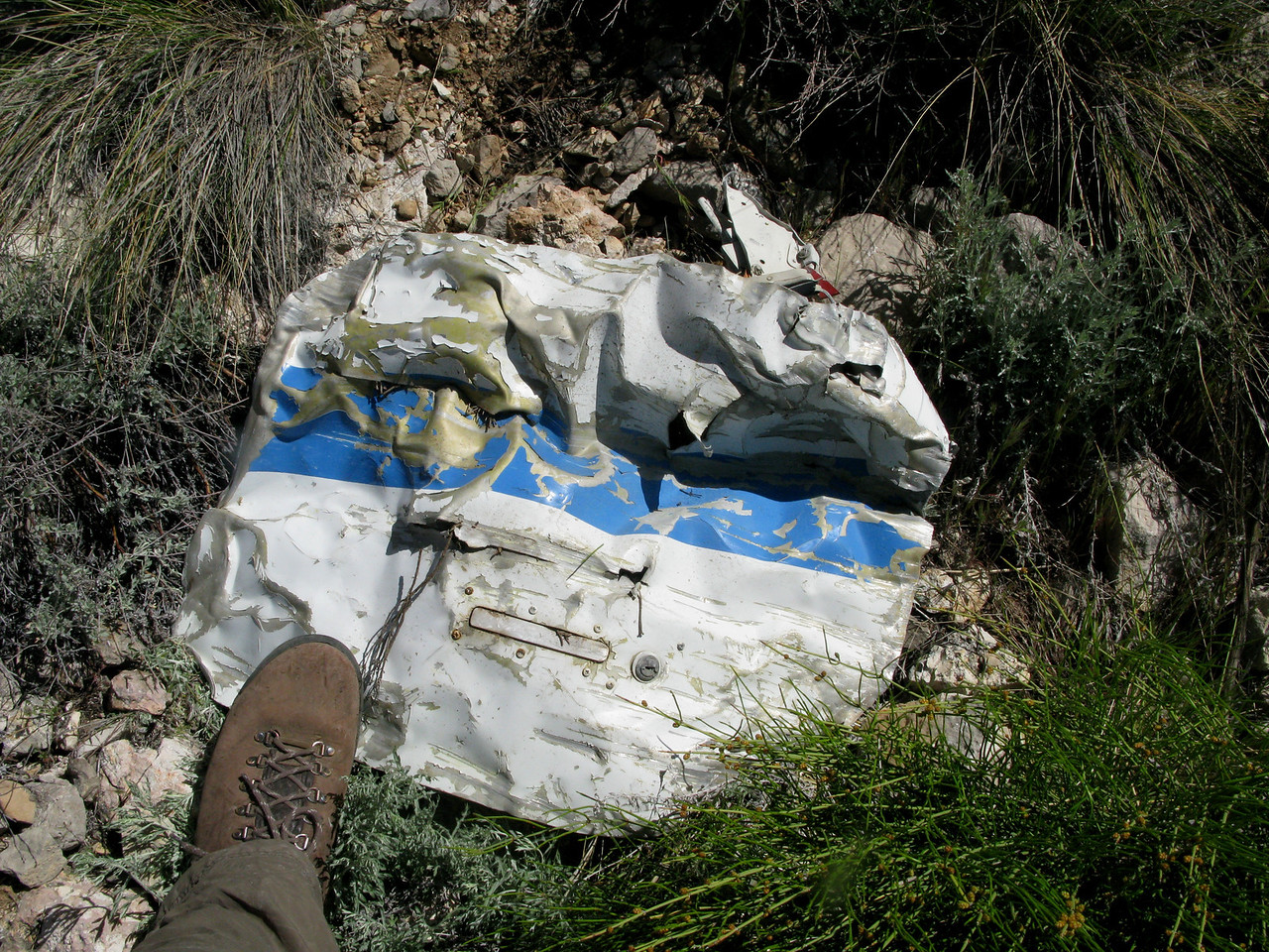 Flight 88's nose baggage door was thrown clear of the main wreckage and was found on the ledge.