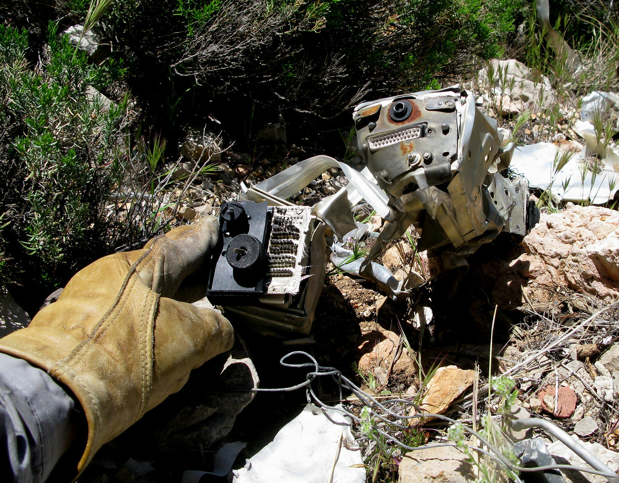 Pictured are two Collins VHF-251 communication radios located amid the wreckage.