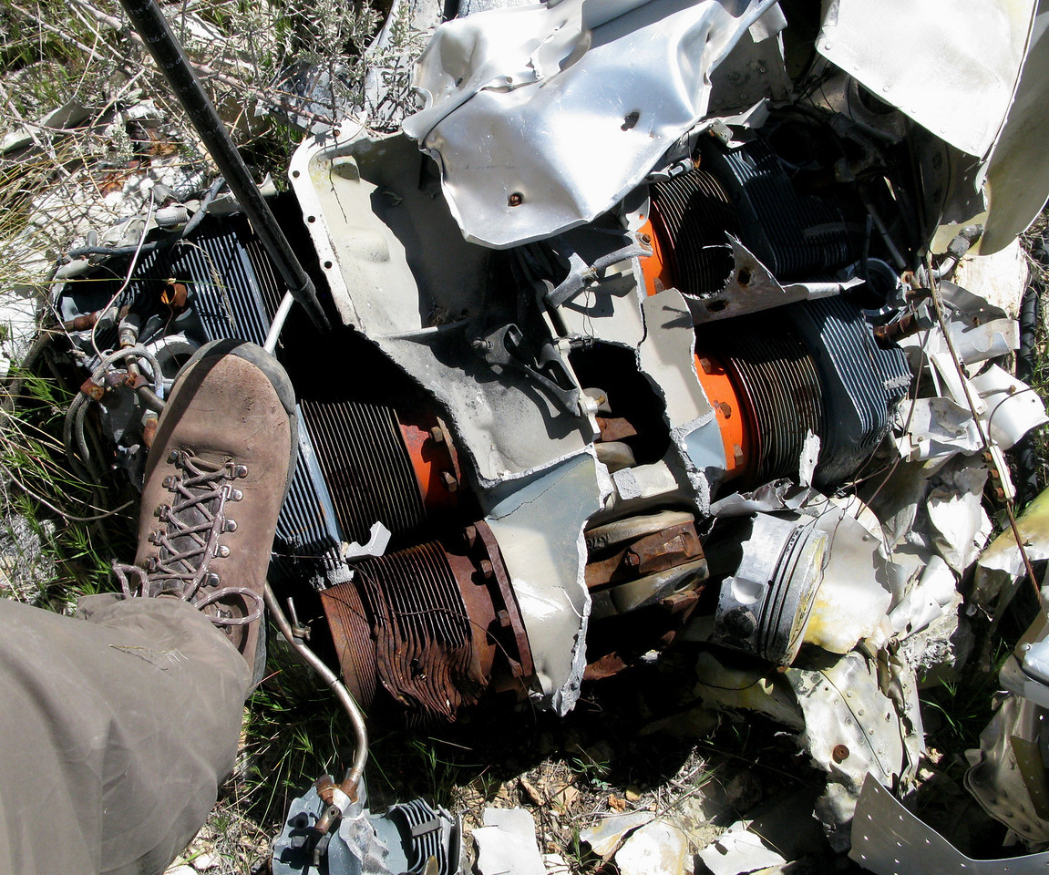 The remains of Flight 88's shattered Lycoming LTIO-540 (left side) engine shows evidence of the tremendous impact with the cliff.<br /> <br /> This engine was located next to the remains of the left wing structure.