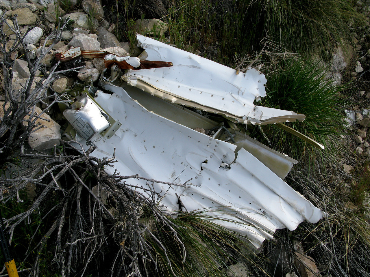 This fragment of wingtip was identifiable only by the strobe light power supply that was still attached to the structure.