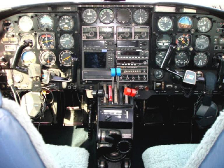 A typical instrument equipped Piper Navajo Chieftain cockpit featured a variety flight instruments and avionics to aid the pilot in navigating safely in low visibility conditions.