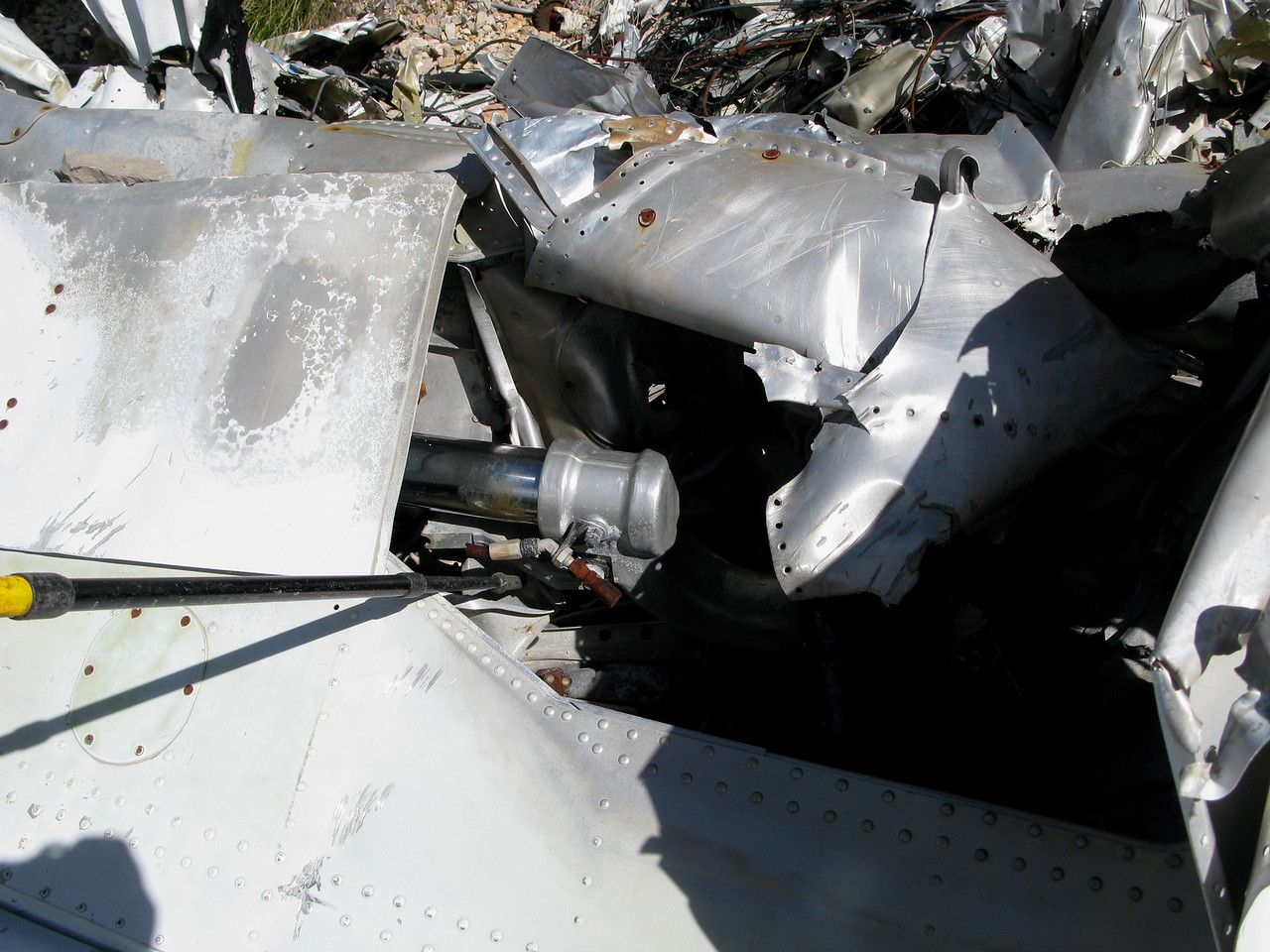 The right main landing gear strut was still attached and in the retracted position, but the wheel and tire assembly was missing and not located at the site.