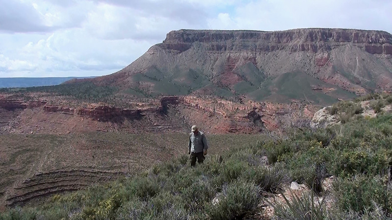 """With Gus's Plateau (background) only a few miles away, it took some time to search for a route to hike down to the next level.<br /> <br /> In the Grand Canyon there are no straight line hiking routes. A point to point 5 mile route often means a 15 mile hike or more through the rough """"staircase"""" type terrain."""