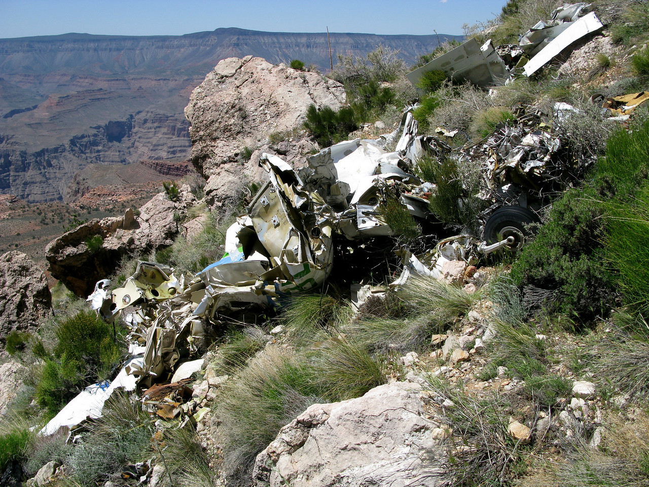 The fuselage of the Piper Chieftain was literally ripped apart by the tremendous impact against the cliff.