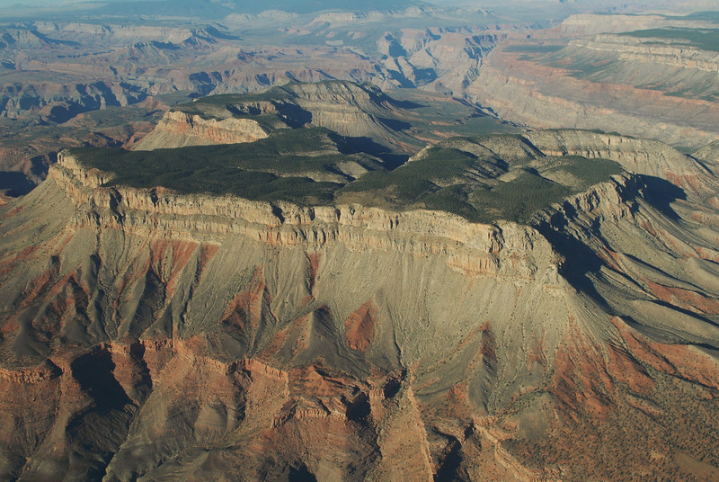 """GUS's PLATEAU""<br /> <br /> After the accident, this freestanding mesa became known as ""Gus's Plateau"" by fellow air tour pilots and friends of Captain Wallace Gustafson. <br /> <br /> The 6,400 foot formation of sedimentary limestone and sandstone is located in the mid-western portion of the Grand Canyon. The plateau is encompassed by the Hualapai Indian Reservation and therefore requires a special permit from the tribe to access."