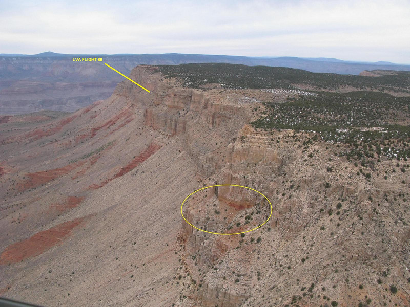 This aerial photo illustrates the distance from the southeast corner of the mesa to the crash site of LVA Flight 88.<br /> <br /> The entire ledge is hazardous, but the area circled represents the steepest and most exposed point while traversing the ledge.